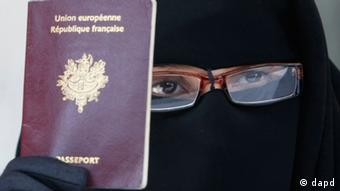 FILE - This May 18 2010 file photo shows a woman, who gave her name as Najat, holding her passport during a press conference in Montreuil, east of Paris. For Muslim women who cover their faces with veils, it is the moment for making plans. Police may be on the prowl when a divisive law against the garments takes effect April 11, 2011. The force of the law is about to fall as the furies rage over what many French Muslims see as a new, broader jab at their religion. (Foto:Remy de la Mauviniere, file/AP/dapd)