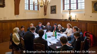 Pictured here, a meeting of The House of Prayer and Learning at Petriplatz Berlin Association