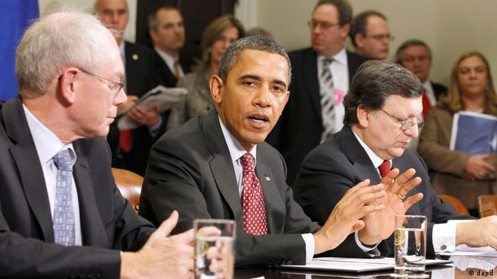 Obama, flanked by Herman Van Rompuy, left, and Jose Manuel Barroso (AP Photo/Haraz N. Ghanbari)