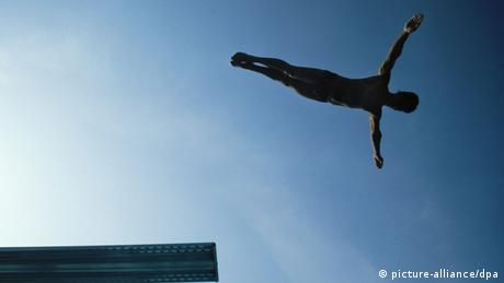 A man jumps into a pool