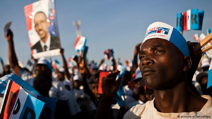 Supporters of Paul Kagame holding a campaign rally in 2010. EPA/CHARLES SHOEMAKER