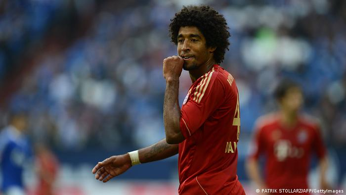 Bayern Munich's Brazilian defender Dante reacts during the German first division Bundesliga football match FC Schalke 04 vs FC Bayern Munich on September 22, 2012 in Gelsenkirchen, western Germany. (Photo via AFP / PATRIK STOLLARZ)