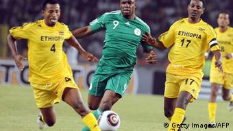 Nigeria's attacker Victor Anichebe (C) struggles for possession of ball with Ethiopian skipper Samson Gebreegziabher (R) and Abebaw Bune during the African Cup of Nations qualifying match between the two countries in Abuja Sunday, March 27, 2011. Nigeria defeated Ethiopia 4 - 0. AFP PHOTO/PIUS UTOMI EKPEI (Photo credit should read PIUS UTOMI EKPEI/AFP/Getty Images)