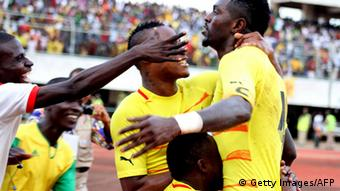 Togolese's striker Emmanuel Adebayor (R) is congratulated by his teammates after scoring a goal during the African Cup of Nations qualifier football match Togo vs Gabon, on October 14, 2012. (Photo: EMILE KOUTON/AFP/GettyImages)
