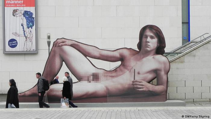 A half naked man, part of a street exhibition in Vienna