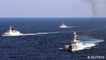 Vessels roam the waters of the East China Sea during a naval exercise, October 19, 2012. The Chinese navy conducted a joint exercise in the East China Sea with the country's fishery administration and marine surveillance agency on Friday. 11 vessels, eight planes and more than 1000 personnels took part in the drill, according to local reports. REUTERS/China Daily (CHINA - Tags: MILITARY) CHINA OUT. NO COMMERCIAL OR EDITORIAL SALES IN CHINA