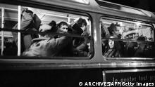 Paris, FRANCE: (FILES) This file picture taken 17 October 1961 in Paris shows Algerian emigrants holding their hands on their heads in a bus after they were arrested by French police during a brutal police crackdown where dozens of Algerian protesters -- some witnesses spoke of 200 -- were killed by police. More than 40 years after the massacre and for the first time, a French fiction movie about the 17 October 1961 events was broadcasted on French television in June 2005. 'Nuit Noire' (dark night), which breaks a taboo in the French recent history, will be also released 19 October in theaters, in DVD, and will be re-broadcasted six times on Canal +. AFP PHOTO/FILES (Photo credit should read ARCHIVES/AFP/Getty Images)