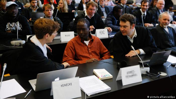 A trial of Somali pirates in a courtroom in Hamburg, Germany. (Photo: Philipp Guelland)