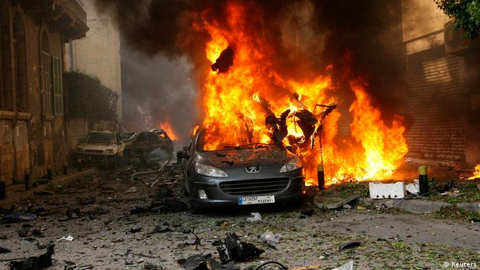 A car burns at the site of the explosion (Photo: Reuters)