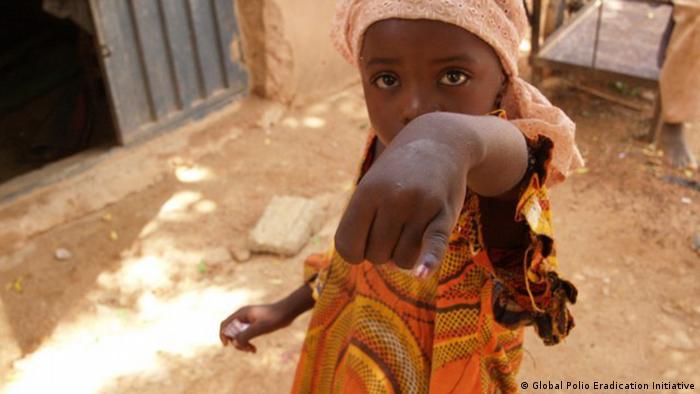 A child receiving a polio vaccination in Nigeria.