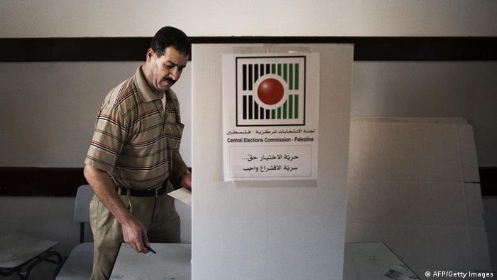 A Palestinian man goes behind a voting booth to pick his candidates for the municipal elections at a polling station in the West Bank city of Ramallah on October 20, 2012. Ballot booths opened across the West Bank as Palestinians began voting in local elections, in what is the first time they have gone to the polls since 2006. AFP PHOTO/MARCO LONGARI (Photo credit should read MARCO LONGARI/AFP/Getty Images)