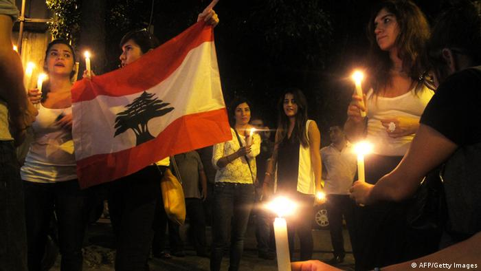 People take part in a candlelight vigil near the site of a car bomb blast in Beirut. (AFP PHOTO/ PATRICK BAZ)