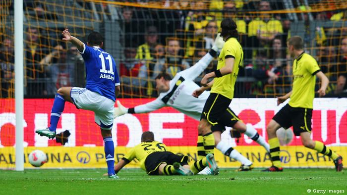 DORTMUND, GERMANY - OCTOBER 20: Ibrahim Affelay (L) of Schalke scores his team's first goal during the Bundesliga match between Borussia Dortmund and FC Schalke 04 at Signal Iduna Park on October 20, 2012 in Dortmund, Germany. (Photo by Alex Grimm/Bongarts/Getty Images)