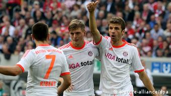 Franck Ribery, Toni Kroos and Thomas Müller (left to right) celebrate a Bayern Munich goal away to Fortuna Düsseldorf. (20.10.2012)