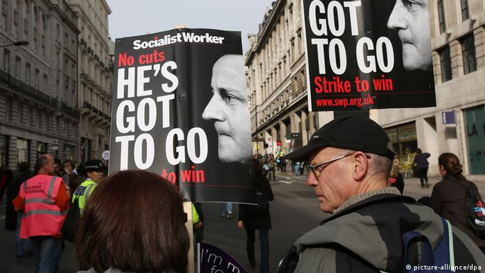 Demonstrators march with posters urging Britain's Prime Minister David Cameron to step down during a Trade Union Congress (TUC) march in London, Britain, 20 October 2012.