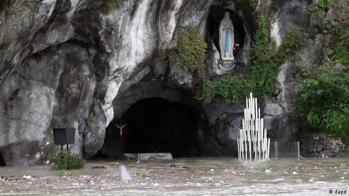 View of the Grotto of Lourdes flooded in southwestern on Saturday, October 20, 2012. (Photo:Bob Edme/AP/dapd)