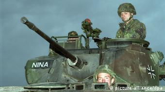 German soldiers atop a tank in Bosnia (Photo: dpa - Bildfunk)