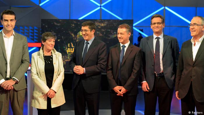 (L-R) Lehendakari (Presidential) candidates for Basque regional elections, Gorka Maneiro (UPD), Laura Mintegi (EH-Bildu), Patxi Lopez (PSE), Inigo Urkullu (PNV), Antonio Basagoiti (PP) and Jose Navas (EB), pose before a televised debate at the EITB studios in San Sebastian October 17, 2012. Basques go to the polls for regional elections on Sunday. REUTERS/Vincent West (SPAIN - Tags: POLITICS ELECTIONS)