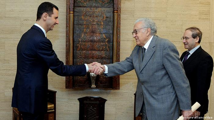 Syrian president Bashar Assad, left, meets with joint UN and Arab League peace envoy Lakhdar Brahimi, center, in Damascus, Syria, on Sunday, October 21, 2012. (EPA/SANA HANDOUT)
