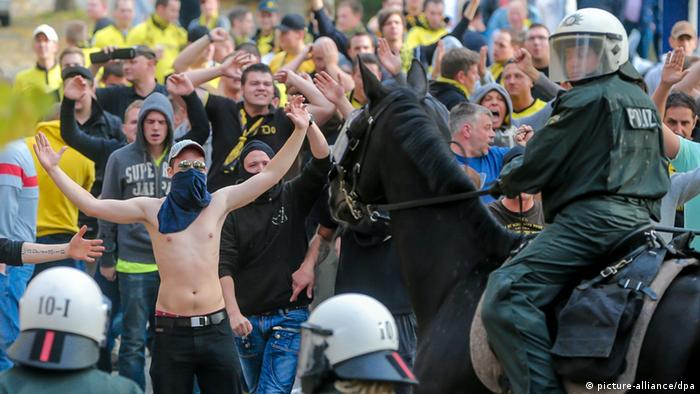Dortmund fans and police officers in a standoff ahead of a game against Schalke