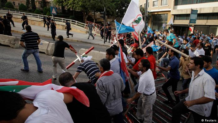 Angry protesters attempt to storm the Lebanese government offices after the funeral of slain intelligence officer Wissam al-Hassan in Beirut on Sunday, October 21, 2012. (Mahmoud Kheir/REUTERS)