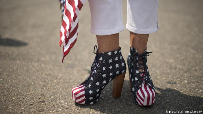 Image #: 19026428 Alice Butter-Short, of Lorton, Virginia, shows off her campaign rally shoes she made prior to Presidential candidate Mitt Romney and U.S. Rep. Paul Ryan (R-WI) at a campaign rally in Manassas, VA., August 11, 2012. Romney announced Ryan, a seven year term congressman as his Vice Presidential running mate this morning in Norfolk, VA. UPI/ Ken Cedeno /LANDOV pixel