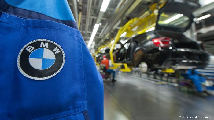 A BMW logo is seen on a jacket at the BMW plant in Regensburg, Germany