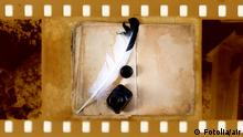 old 35mm frame photo with vintage book inkwell and feather Copyright: Fotolia/air #6214663