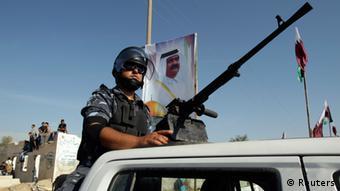 A member of Hamas' security forces stands (photo: REUTERS/ Ibraheem Abu Mustafa)