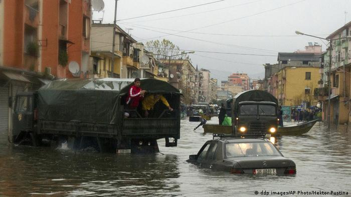 Half-submerged cars on a street in Albania