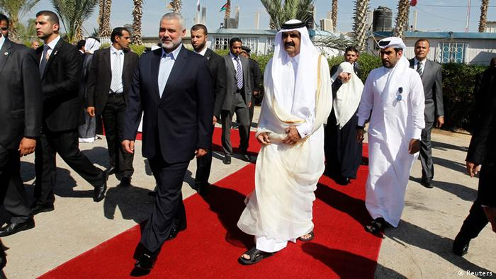 Hamas Prime Minister Ismail Haniyeh with the Emir of Qatar Sheik Hamad bin Khalifa al-Thani (photo: REUTERS/Mohammed Abed)