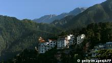 A view of the Dharamshala town is seen amidst the Dhauladhar range of mountains from the Namgyal Monastry on September 26, 2012. About 400 Tibetans from around the world are in the northern Indian hilltown of Dharamshala for the biggest gathering of exiles in four years called to highlight the plight of Tibetans under Chinese rule. AFP PHOTO/Manjunath KIRAN (Photo credit should read Manjunath Kiran/AFP/GettyImages)