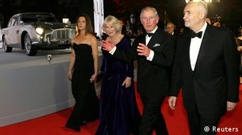 Britain's Prince Charles and Camilla, Duchess of Cornwall are escorted by producers Michael G. Wilson and Barbara Broccoli as they arrive for the royal world premiere of the new 007 film Skyfall at the Royal Albert Hall in London (Photo: REUTERS/Kirsty Wigglesworth)