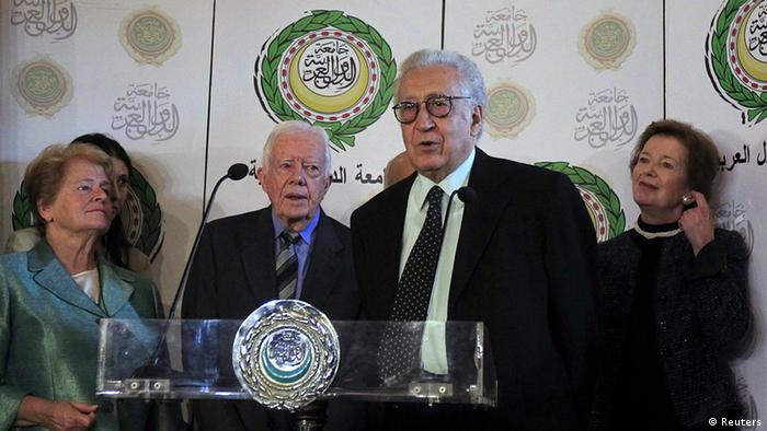 International peace envoy for Syria Lakhdar Brahimi (2nd R) speaks at a news conference at the Arab League headquarters in Cairo October 24, 2012. Syria said on Wednesday its military command was still studying a proposal for a holiday ceasefire with rebels - contradicting international mediator Brahimi's earlier announcement that Damascus had agreed to a truce. Also pictured are former Irish president Mary Robinson (R), former Norwegian prime minister Gro Harlem Brundtland (L) and former U.S. president Jimmy Carter. REUTERS Mohamed Abd El Ghany (EGYPT - Tags: POLITICS CONFLICT)