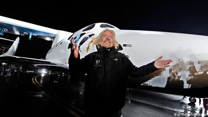 Head the Virgin Group, British, Sir Richard Branson stands in front of SpaceShipTwo during the rocket plane's worldwide debut at an event for dignitaries and future 'astronauts in Mojave, California, USA on 07 December 2009. Virgin Galactic unvieled SpaceShipTwo, on 07 December 2009 after secret development for the past two years. The company plans to sell suborbital space rides for 200,000 US dollars on134,695 euros a ticket, offering passengers two and a half hour-hour flights that include around five minutes of weightlessness. EPA/ANDREW GOMBERT