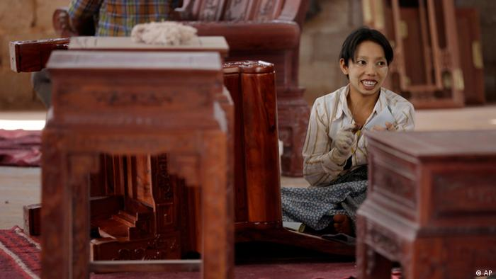 Burmese worker at a rosewood furniture factory in Ruili, near Myanmar border, Yunnan Province, China
