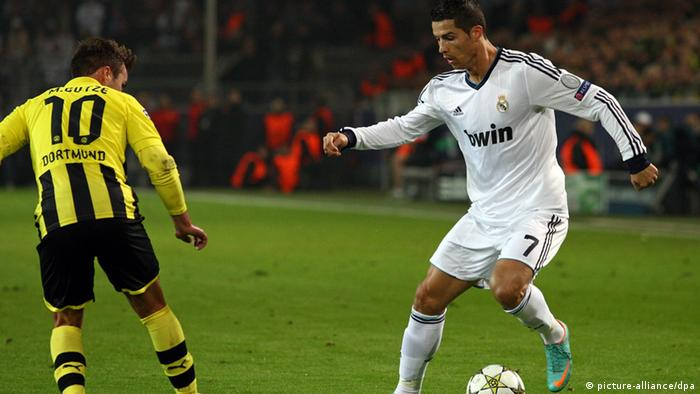 Dortmunds Mario Götze (L) and Real Madrid's Cristiano Ronaldo vie for the ball during the Champions League Group D soccer match between Borussia Dortmund and Real Madrid at BVB Stadium Dortmund in Dortmund, Germany, 24 October 2012. Photo: Kevin Kurek/dpa
