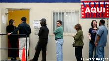 US voters wait in line at a polling place