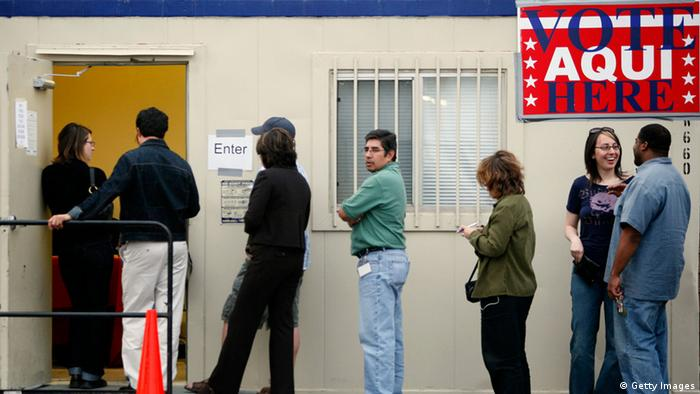 Voters wait outside a polling place in a trailer at a grocery store parking lot in Austin, Texas.
