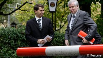 File picture shows Bavarian Prime Minister and leader of the Christian Social Union (CSU) Horst Seehofer (R) and CSU speaker Hans Michael Strepp as they arrive for a CSU board meeting in Munich October 19, 2009. Strepp has resigned on October 25, 2012 after allegations of trying to influence German television channel ZDF. Picture taken October 19, 2009. REUTERS/Michaela Rehle/File (GERMANY - Tags: POLITICS)