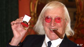 A picture of the late Jimmy Savile, former BBC presenter, who is now engulfed in allegations of child abuse whilst he was working at the BBC (Photo: Lewis Whyld/PA, File/AP/dapd)