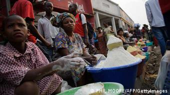 Congolese women and girls sell manioc flour on the side of a pavement in the market district of Goma in the east of the Democratic Republic of Congo on July 18, 2012. Fufu, a dish made by mixing the flour with water, forms a staple of the Congolese diet. AFP PHOTO/PHIL MOORE (Photo credit should read PHIL MOORE/AFP/GettyImages)