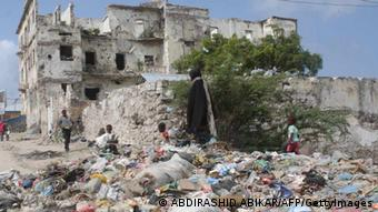 Refugee Children collecting scrape materials in a place full of waste in Mogadishu on July 20, 2012 .AFP PHOTO/ABDIRASHID ABIKAR