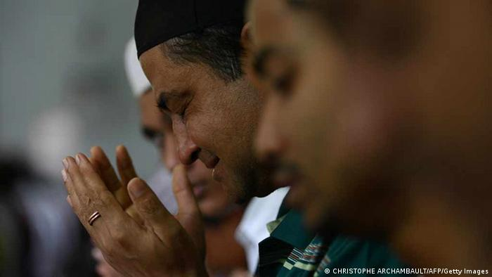 To go with AFP story Myanmar-unrest-religion-rights,FOCUS by Amelie Bottollier-Depois This picture taken on October 12, 2012 shows a tearful Muslim Rohingya man praying at a mosque during Friday prayers in the Aung Mingalar quarter, turned into a ghetto after violence wracked the city of Sittwe, capital of Myanmar's western Rakhine state. Barbed wire and armed troops guard the Muslim quarter of a violence-wracked city in western Myanmar, a virtual prison for the families that have inhabited its narrow streets for generations. AFP PHOTO /Christophe ARCHAMBAULT (Photo credit should read CHRISTOPHE ARCHAMBAULT/AFP/Getty Images)