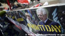 Demonstrators hold a banner showing Italian Prime Minister Mario Monti and German Chancellor Angela Merkel at the start of the No Monti Day demonstration on October 27, 2012 in Rome. The No Monti Day demonstration is organized by the small left-wing parties and various protest groups against Italian Prime Minister Mario Monti's austerity measures. AFP PHOTO / FILIPPO MONTEFORTE (Photo credit should read FILIPPO MONTEFORTE,FILIPPO MONTEFORTE/AFP/Getty Images)