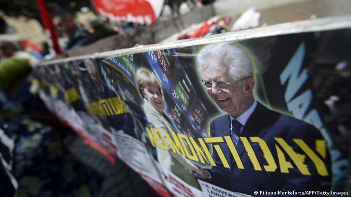 Demonstrators hold a banner showing Italian Prime Minister Mario Monti and German Chancellor Angela Merkel (Photo: FILIPPO MONTEFORTE,FILIPPO MONTEFORTE/AFP/Getty Images)