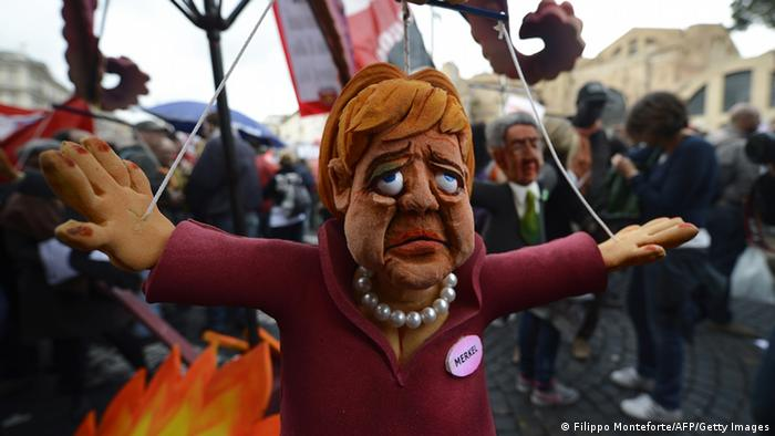 A puppet showing German Chancellor Angela Merkel is displayed at the start of the No Monti Day demonstration in Rome.