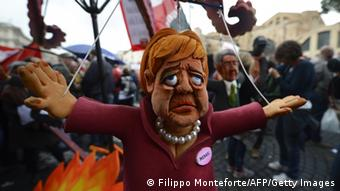A puppet of Angela Merkel at a protest in Rome