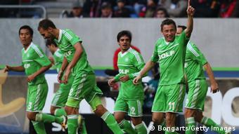 DUESSELDORF, GERMANY - OCTOBER 27: Ivica Olic (2nd R) of Wolfsburg celebrates with his team mates after scoring his team's second goal during the Bundesliga match between Fortuna Duesseldorf 1895 and VfL Wolfsburg at Esprit-Arena on October 27, 2012 in Duesseldorf, Germany. (Photo by Joern Pollex/Bongarts/Getty Images)