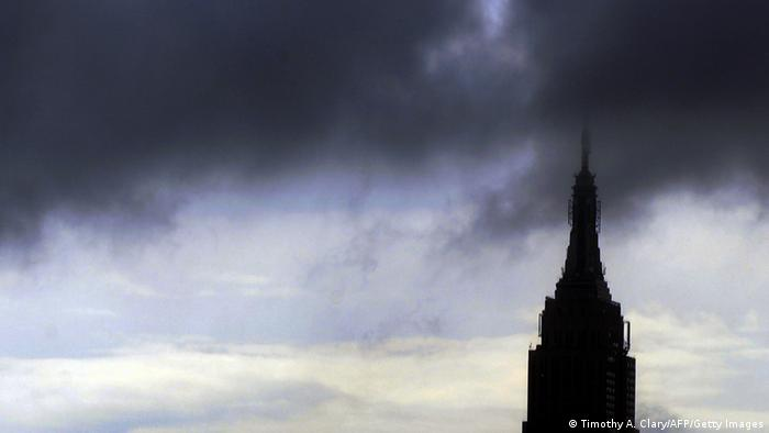 Rain and dark clouds PASS over the Empire State Buidling in New York ON August 25 ,2011. New York City is bracing for the arrival of Hurricane Irene. Forecasters are expect it to move up the east coast, where it could hit New York City by late Saturday or Sunday. AFP PHOTO / TIMOTHY A. CLARY (Photo credit should read TIMOTHY A. CLARY/AFP/Getty Images)